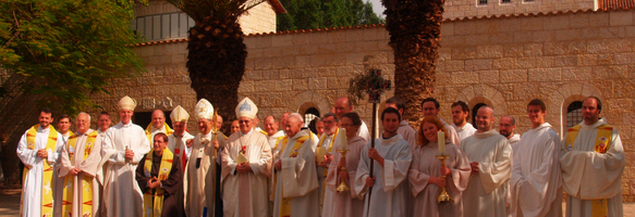 Bishops, monks, guest priests and volunteers in front of the basilica.